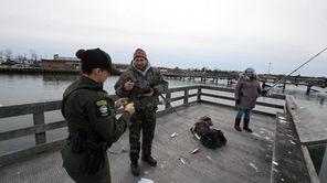 State environmental conservation policemen patrol Long Island's shores