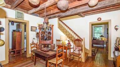 The East Setauket house includes wide-plank hardwood flooring,