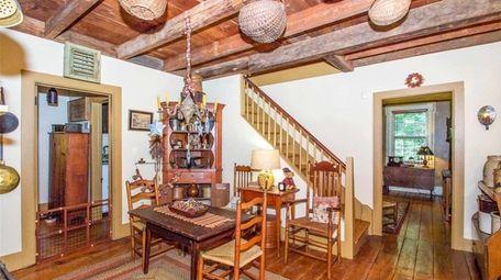 The East Setauket house includes wide-plank hardwood flooring,