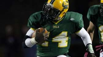 Lynbrook's Paul Magloire takes off for big yards.