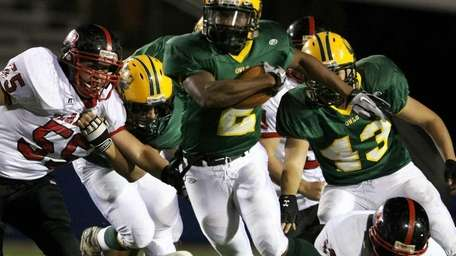 Launched into the open field is Lynbrook's Travis