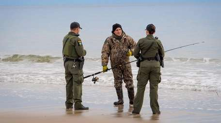 DEC Environmental Conservation Officers Christopher Macropoulos, left, and