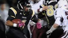 St. Anthony's High School Dariyan Riley rushes for