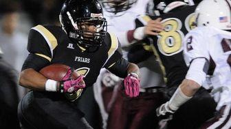 St. Anthony's High School Dariyan Riley rushes for
