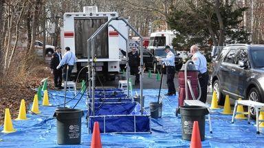 Hazmat crews prepare decontamination stations at the scene