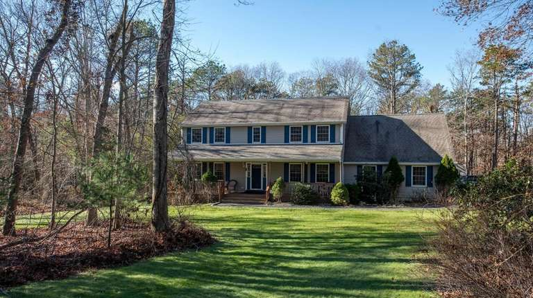 The four-bedroom, 2½-bath Colonial is set on a