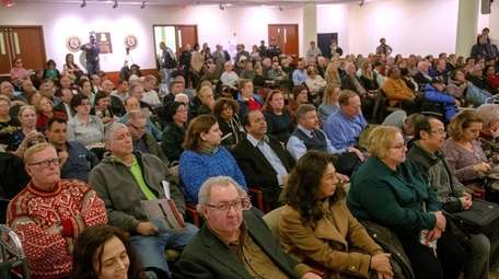 Crowds fill the legislature chambers and overflow rooms