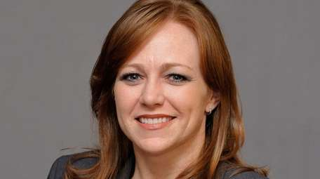 Tara Scully, shown at her Port Jefferson office