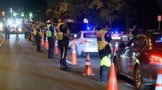 Nassau County police perform DWI checks on Sunrise