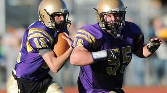 Sayville's Steven Ferreira with Casey Boos (55) leading