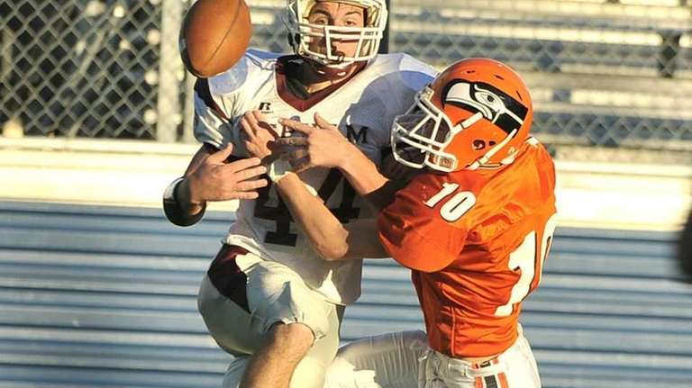 Carey's Mike Dziubela breaks up a pass to