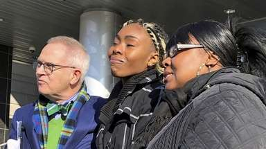 Jazmine Headley, center, joins attorney Brian Neary and