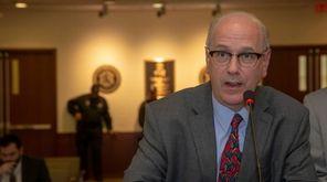 Nassau County Assessor David Moog addresses the Nassau