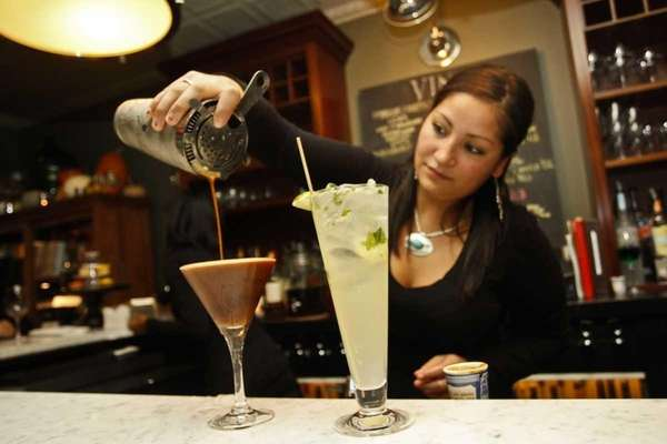 Bartender Elizabeth Jimenez makes drinks at Vine and