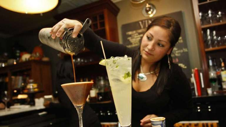 Bartender Elizabeth Jimenez makes drinks at Vine and