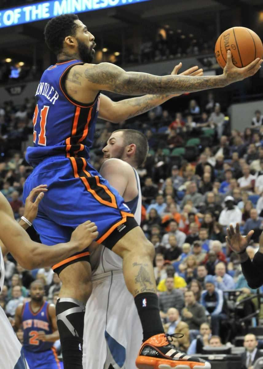 Wilson Chandler, left, crashes into Minnesota's Kevin Love