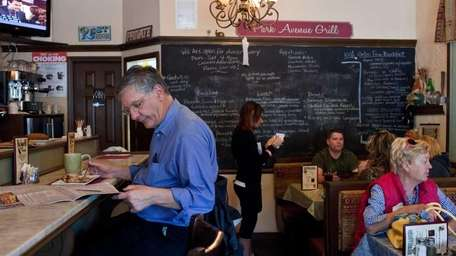 Sere Pollin writes down lunch orders at the