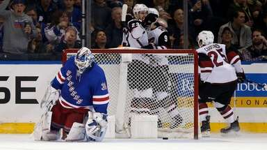 Henrik Lundqvist #30 of the Rangers looks on