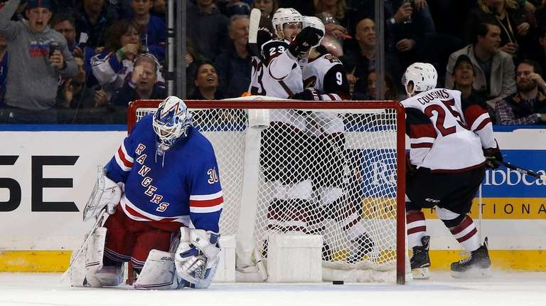 Henrik Lundqvist #30 of the Rangers looks on