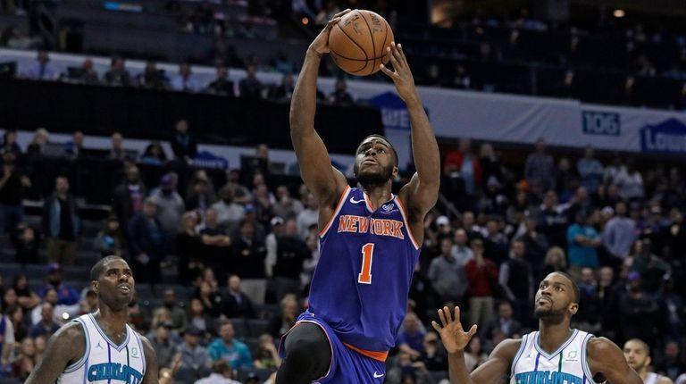 Knicks' Emmanuel Mudiay (1) drives past Charlotte Hornets'