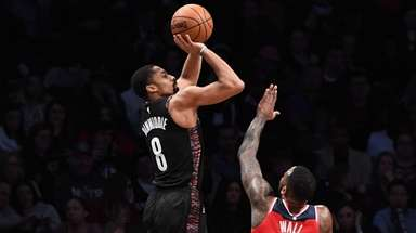 Nets guard Spencer Dinwiddie shoots a three-point basket