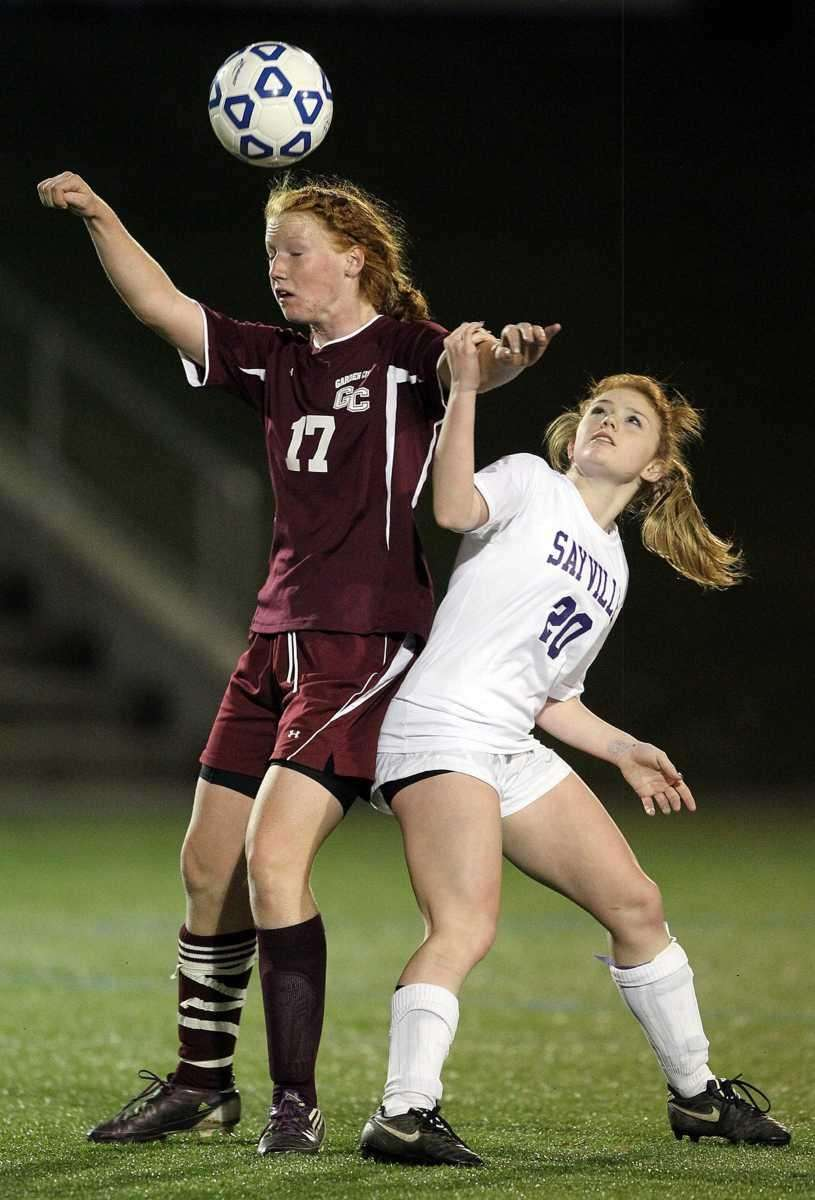 Garden City's Barbara Sullivan wins the header over