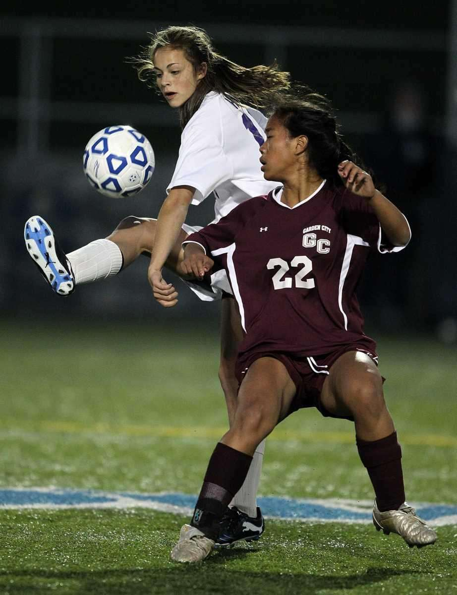 Sayville's Madison Hoon (10) kicks around Garden City's