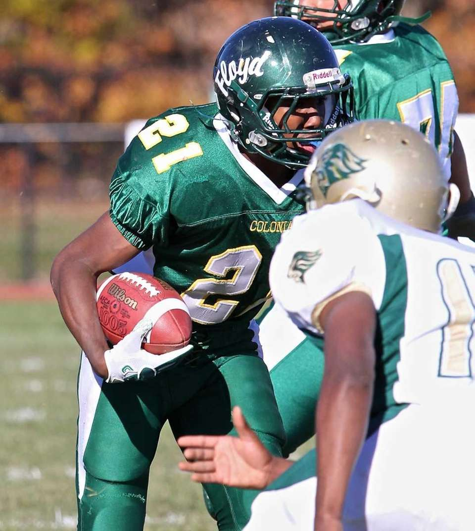 Floyd running back Stacey Bedell #21 looks for