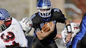 Glenn quarterback Ryan Rielly gains yardage through Mt.