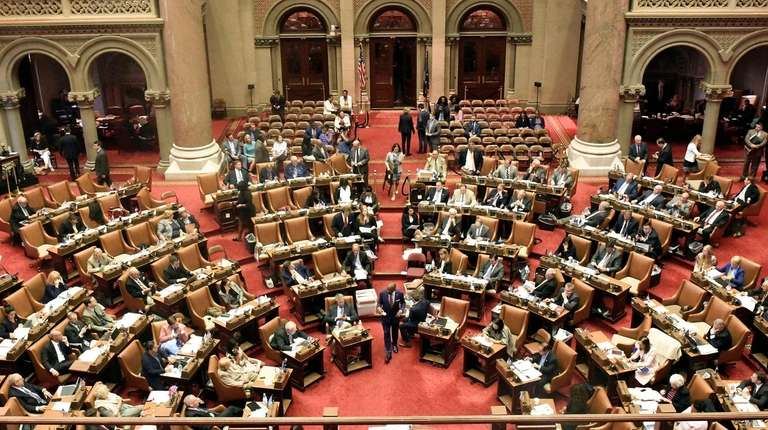 Assembly members vote in the Assembly chamber at