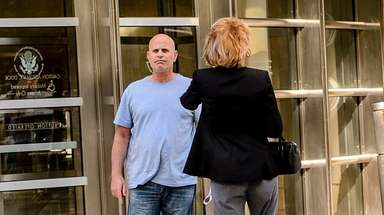 Anthony Vassallo, left leaves Brooklyn Federal Court after
