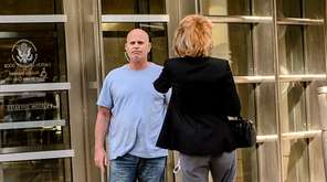Anthony Vassallo, left, leaves federal court in Brooklyn