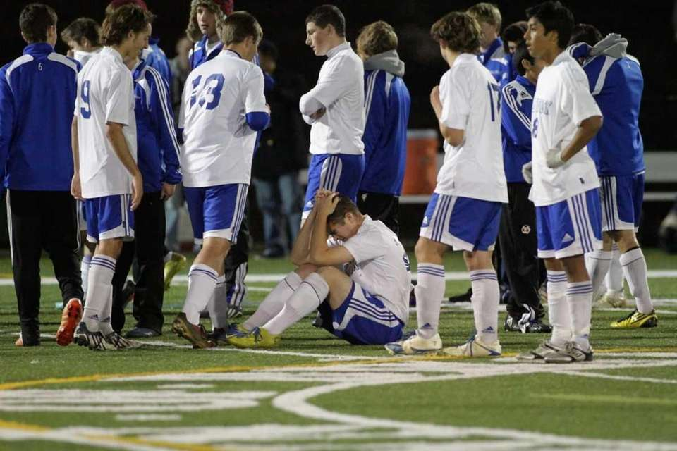 Mattituck's #23 Kevin Reyer (center) and his teammates
