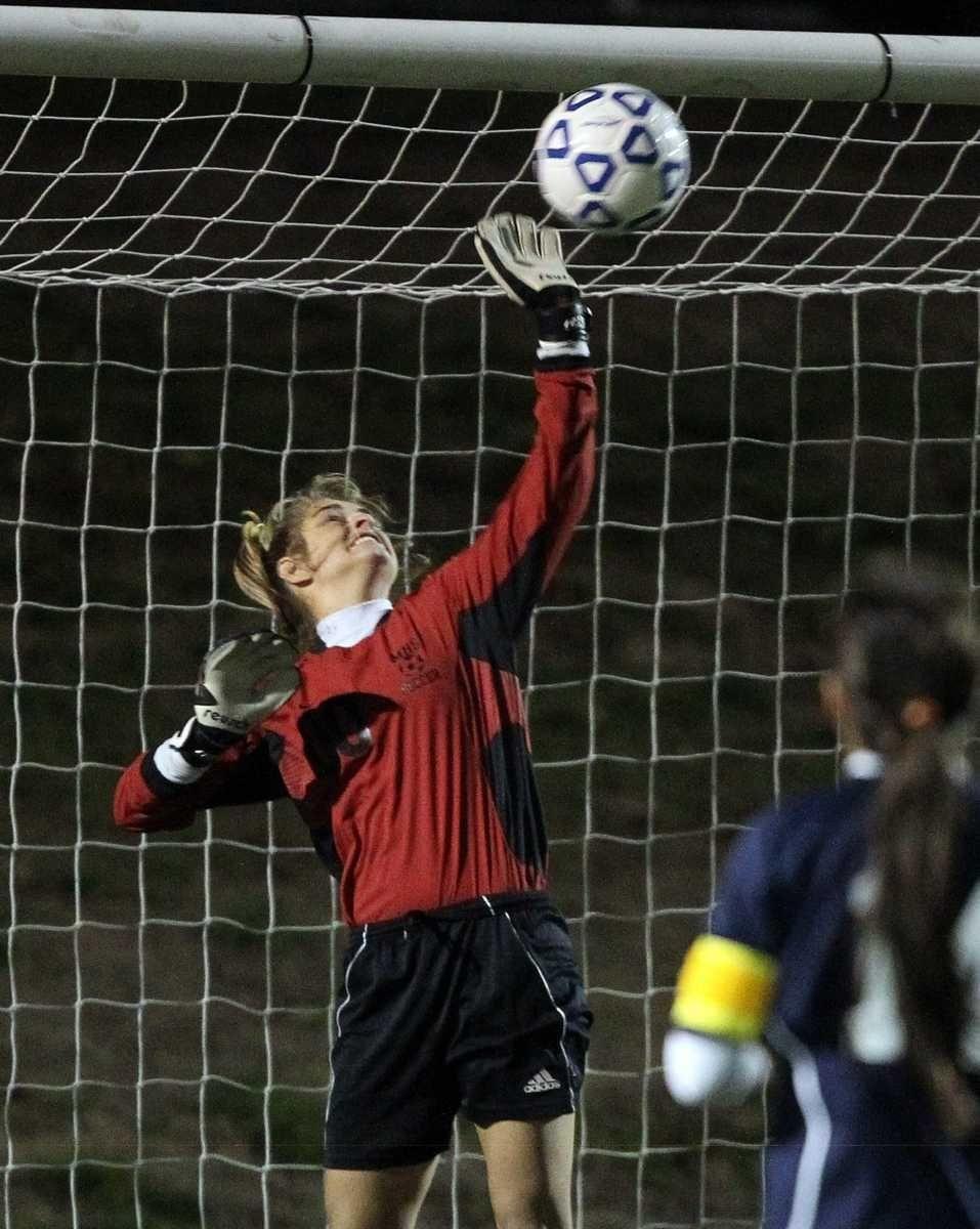 Massapequa's keeper Emmalee Meyer makes the save against