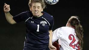 Massapequa's Taylor Elliot (1) with the header over
