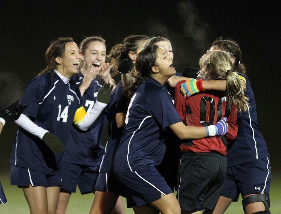 Massapequa girls soccer team celebrates their Class AA