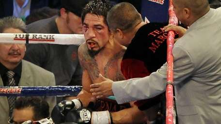 Antonio Margarito of Mexico listens to members of