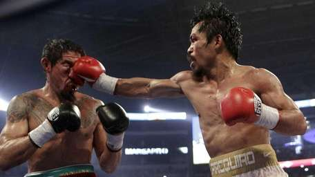 Manny Pacquiao, right, lands a punch against Antonio