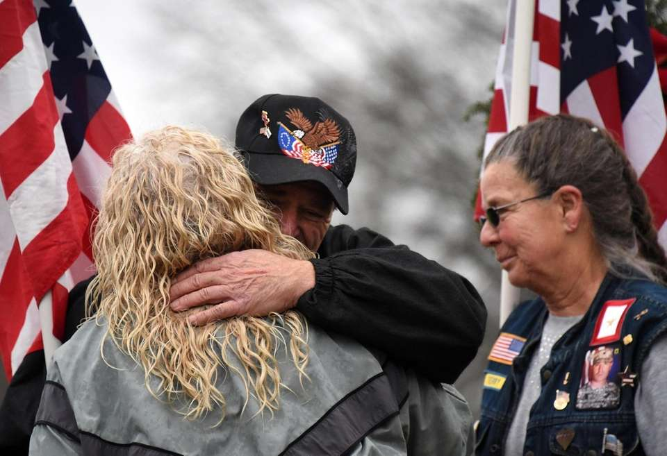 Gold Star families embrace prior to laying wreaths