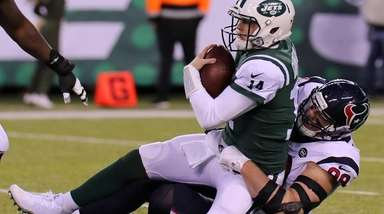 Jets QB Sam Darnold gets sacked by Texans