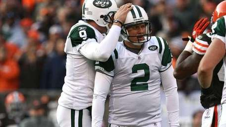 Jets kicker Nick Folk is comforted by punter