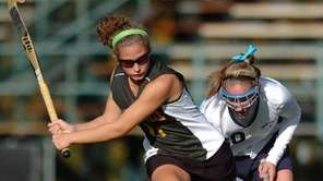 Ward Melville's Abby Beltrani, left, scored the first