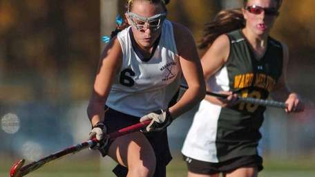 Massapequa's Jamie Ahrens, left, looks to pass away