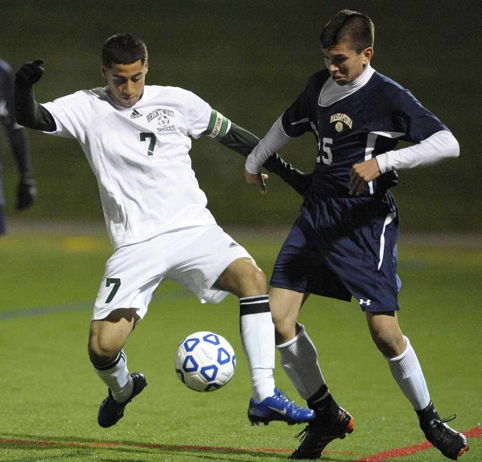 Brentwood's Julio Olivares fights for possession with a