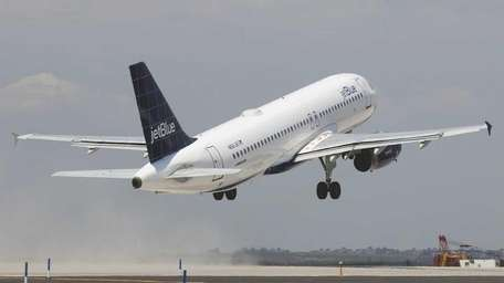 A Jet Blue plane takes off on the