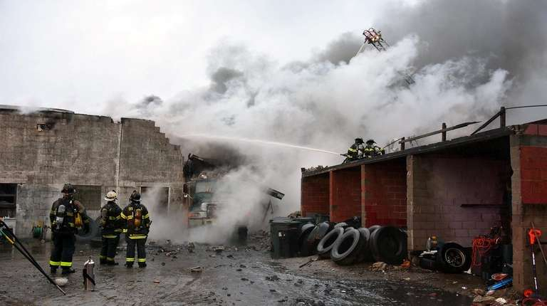 Firefighters work to extinguish a fire at a