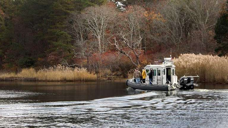 A bay constable's boat follows the meandering path