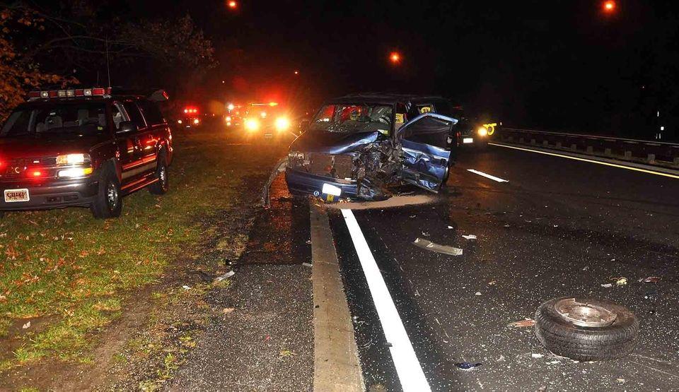 Authorities investigate a van in a wrong-way crash