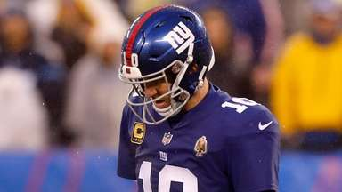 Giants quarterback Eli Manning looks on during the