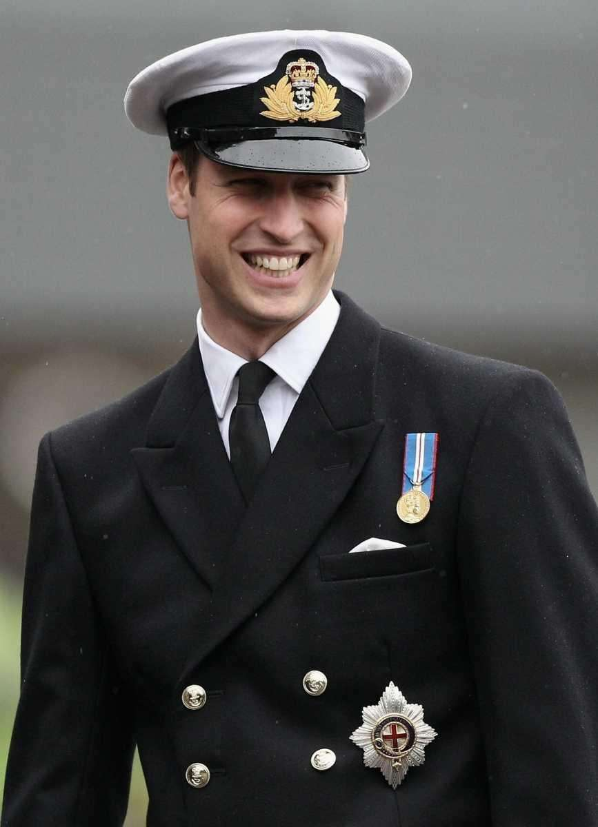 Prince William hands out silver and gold pins